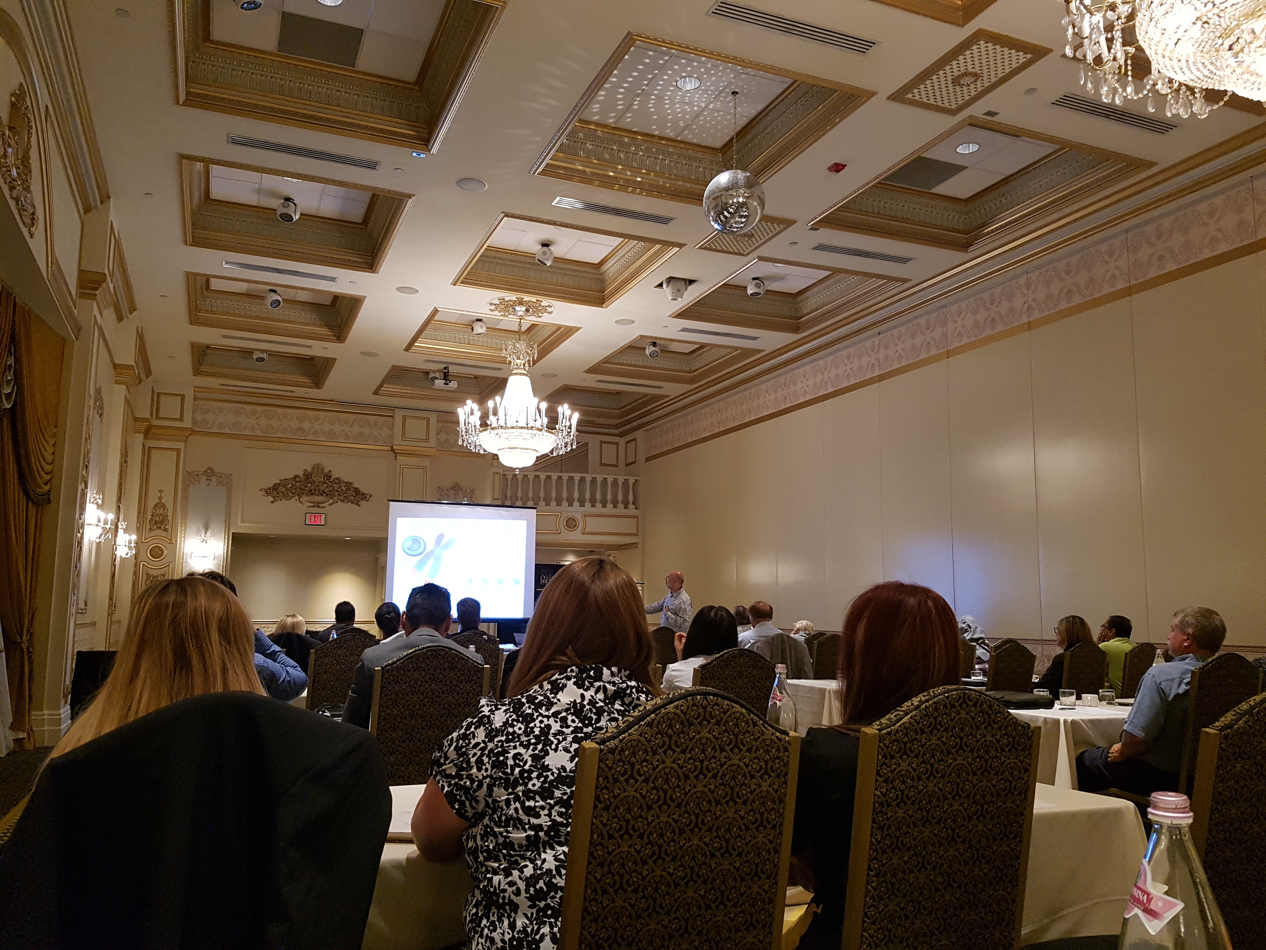 A Presentation in front of a room full of people at Education Day at SCC Ontario