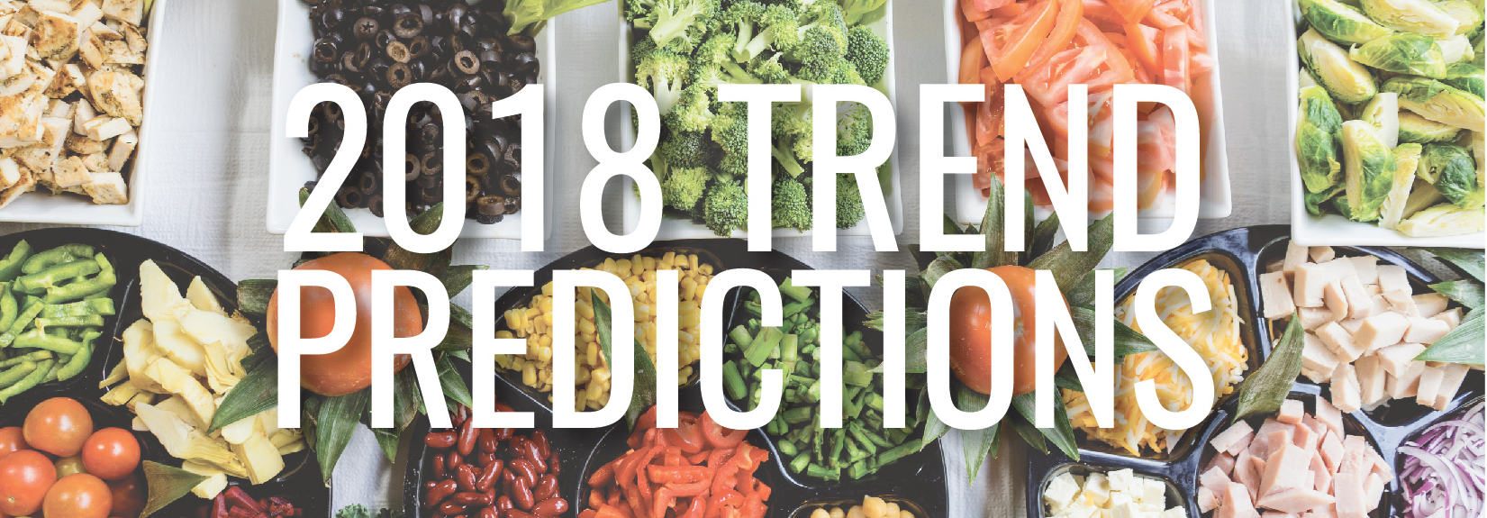 2018 Trend Predictions set over an image of vegetables and fruits and meats and cheeses