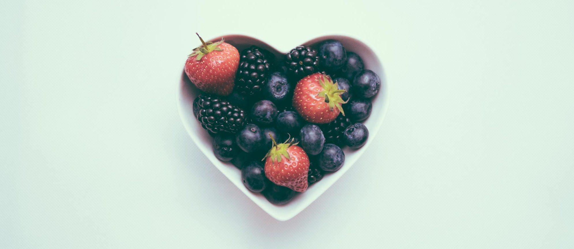 Heart shaped bowl filled with berries