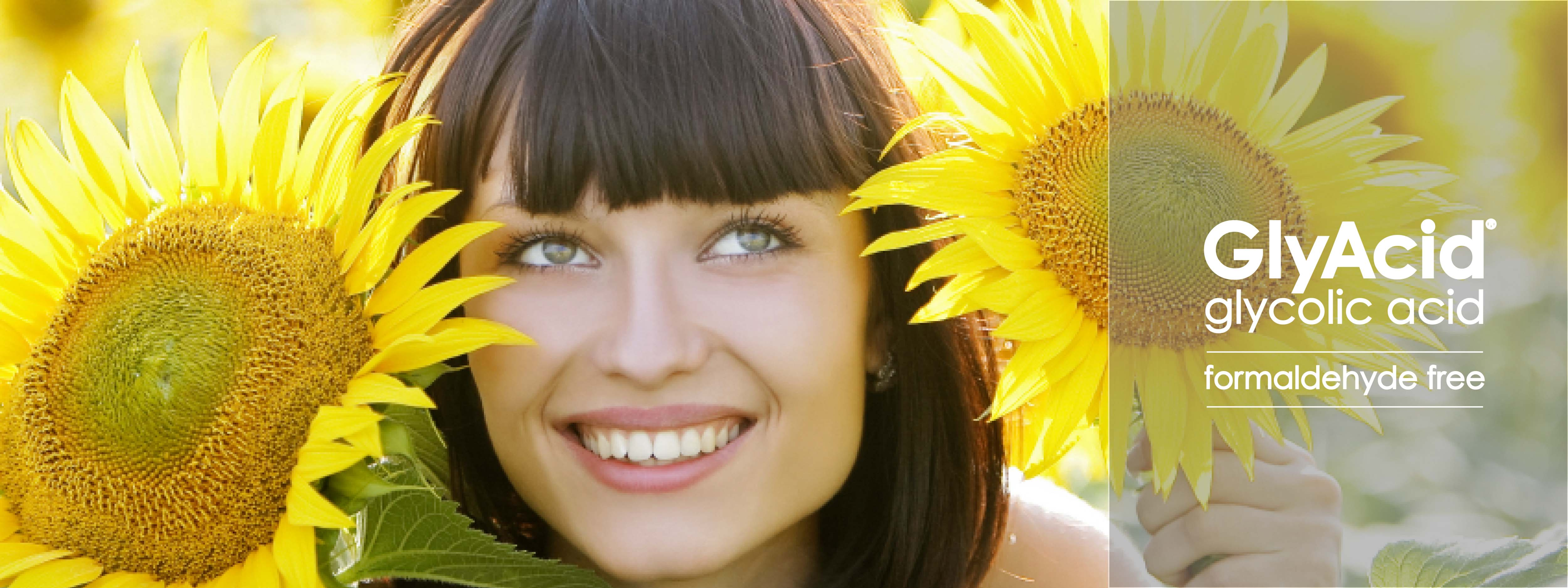 "A woman with two sunflowers beside her face, smiling and looking up with her eyes. Beside her it says ""GlyAcid glycol acid formaldehyde free"""