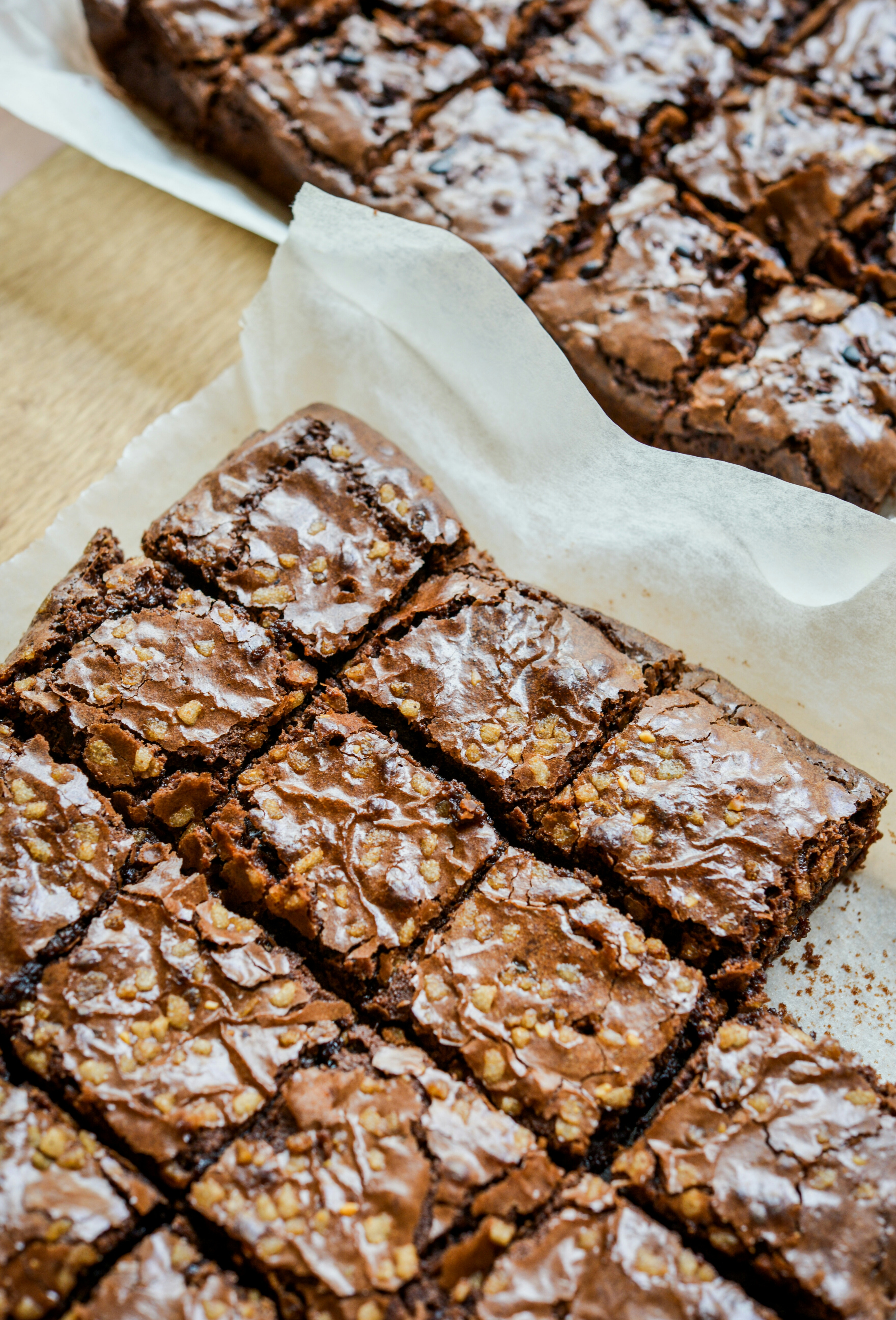 fresh brownies on parchment paper