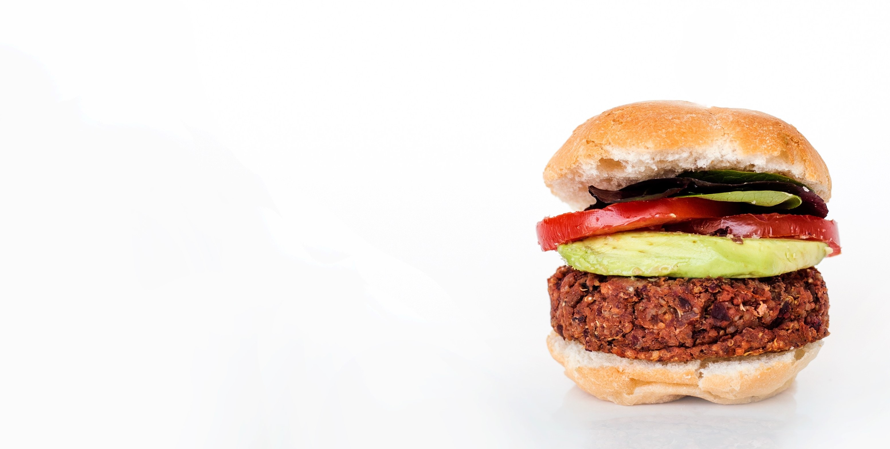 Plant based burger with avocado and tomato