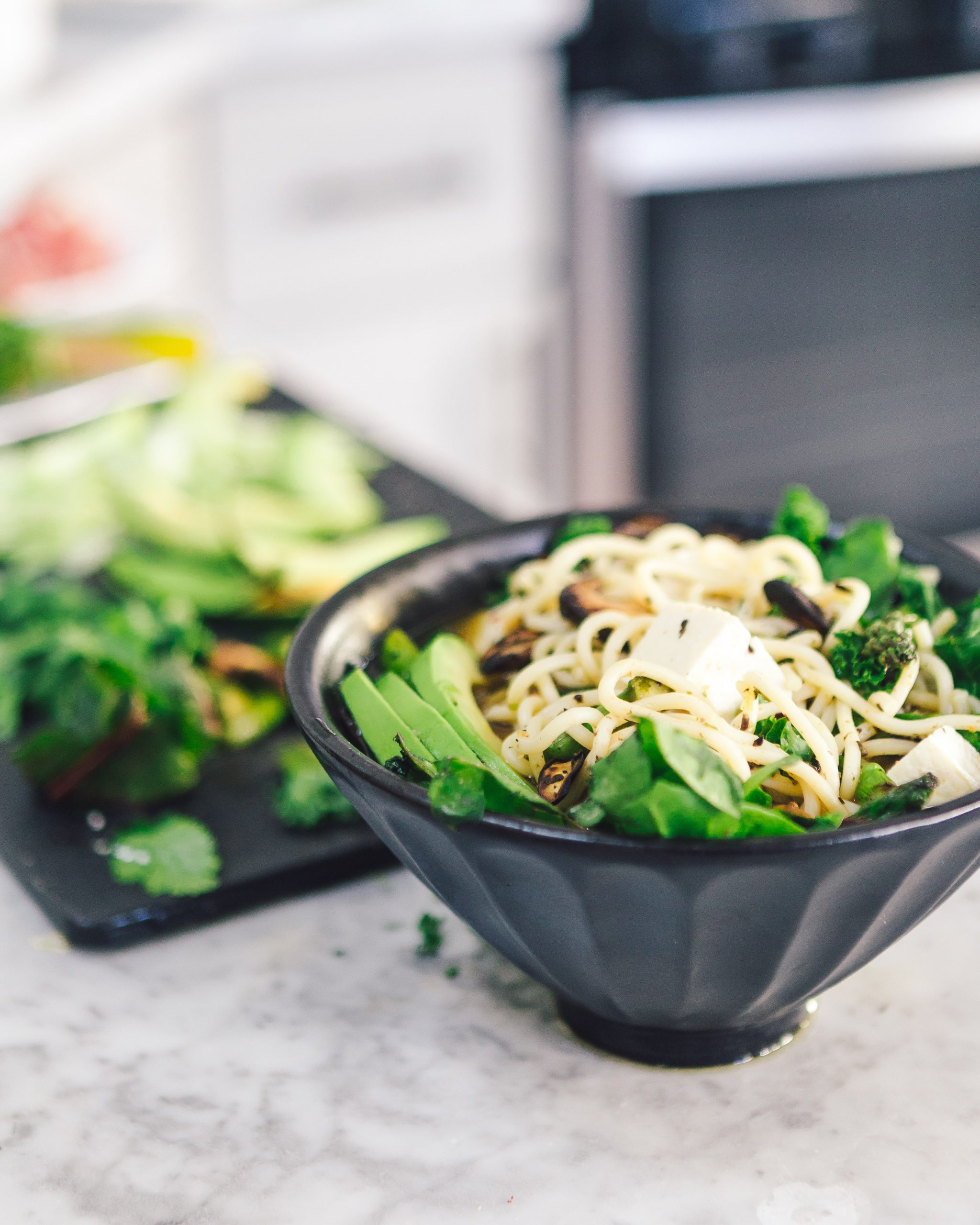 bowl of noodles with tofu and vegetables